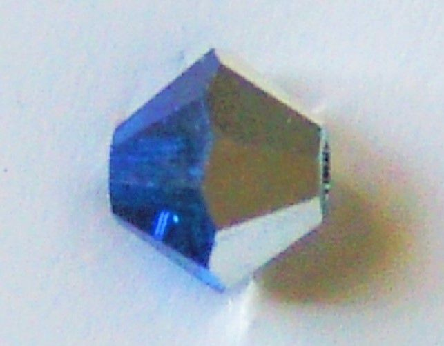 Toupie 5328 Capri Blue Comet Argent Light 4mm x50 Cristal Swarovski